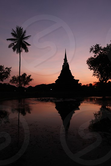 the Wat Mahathat Temple at the Historical Park in Sukothai in the Provinz Sukhothai in the north of Bangkok in Thailand Southeastasia. photo