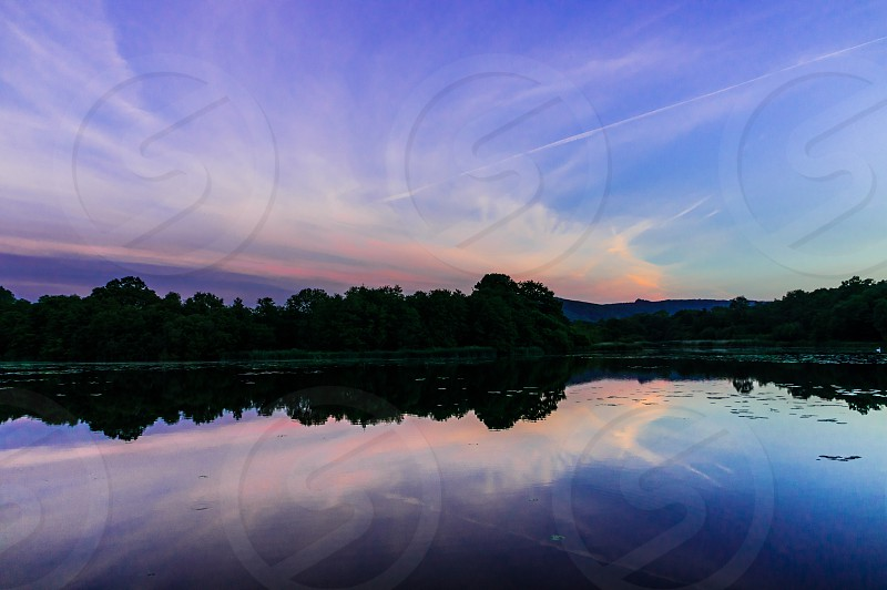 Pond still calm water peaceful tranquility sunset reflections  photo