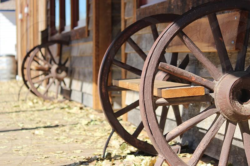 brown wooden wheel bench photo