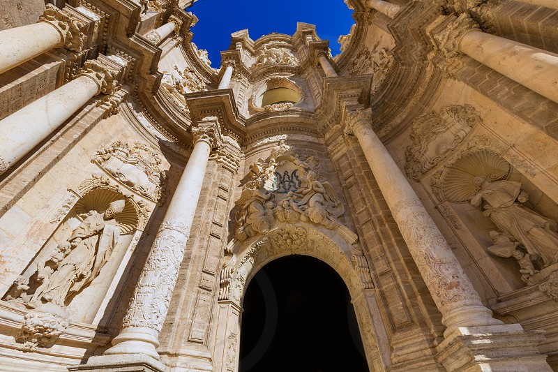 Valencia cathedral door in plaza de la Reina square of Spain photo