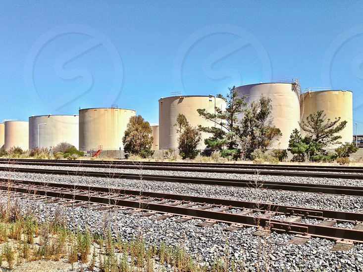 Storage Tanks by railroad tracks  photo