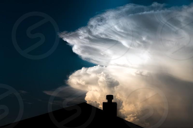 Storm cloud roof house chimney ominous horizontal photo