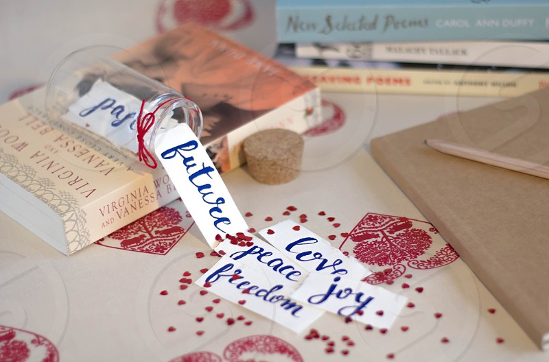 Still life conceptual books words glass jar paper feelings natural light point of view handwriting art photo