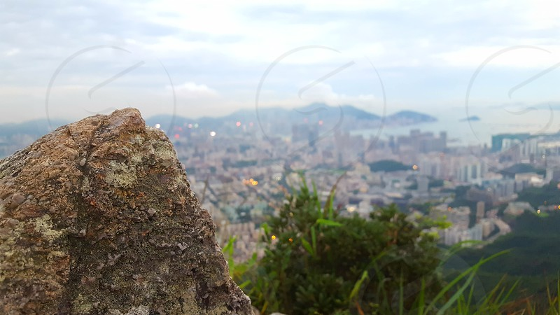 This picture is taken on the Lion Rock in Hong Kong after a 3 hour hike we finally reached the top to see this magnificent view of one of the most incerdible cities in the world. photo