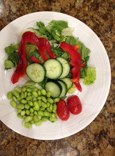 sliced vegetables in white plate photo