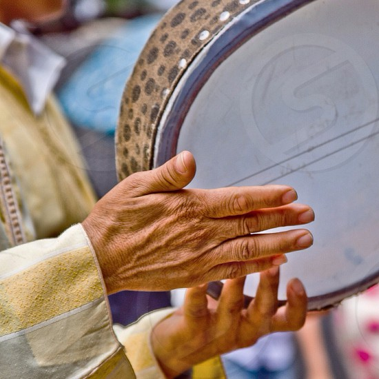 person holding a tambourine photo