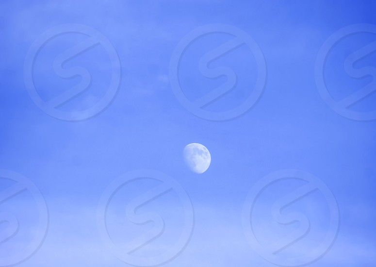 Daytime moon photo