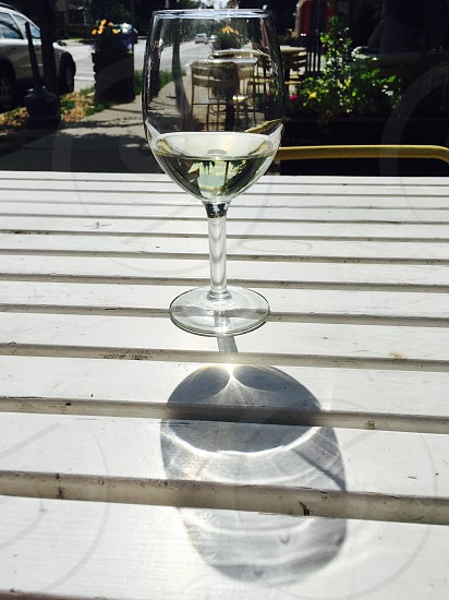 Wine sunny reflection sidewalk cafe cafe summer peace photo