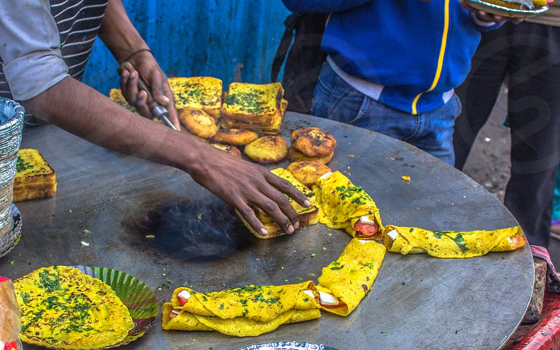 The art of making food is not only in the taste it produces but also in the speed and accuracy mixed with consistency of the produce. Splendid to watch yummy to taste and a pleasure to capture. Shot in Delhi's old city area - Chandni Chowk photo