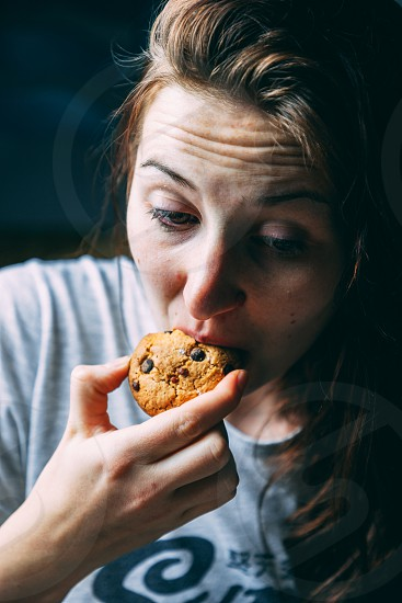 Girl eating a Chocolate Chip Cookie photo