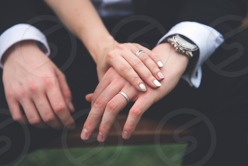 Rings on the hands of newlyweds. photo