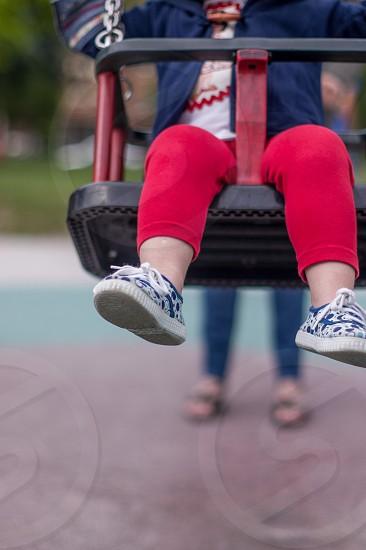 girl swinging photo