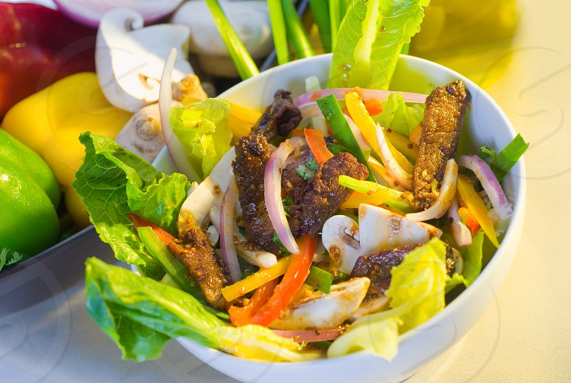 fresh colorfull thai beef salad on a bowl close up photo