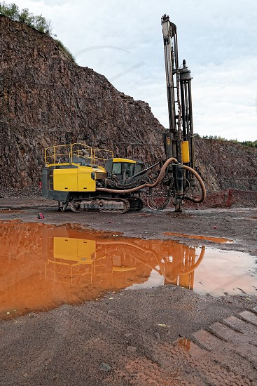 driller in a quarry mine. porphyry rocks. mining industry. photo