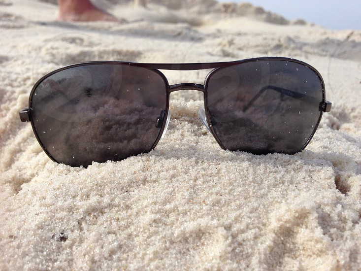 Sunglasses and sand  photo