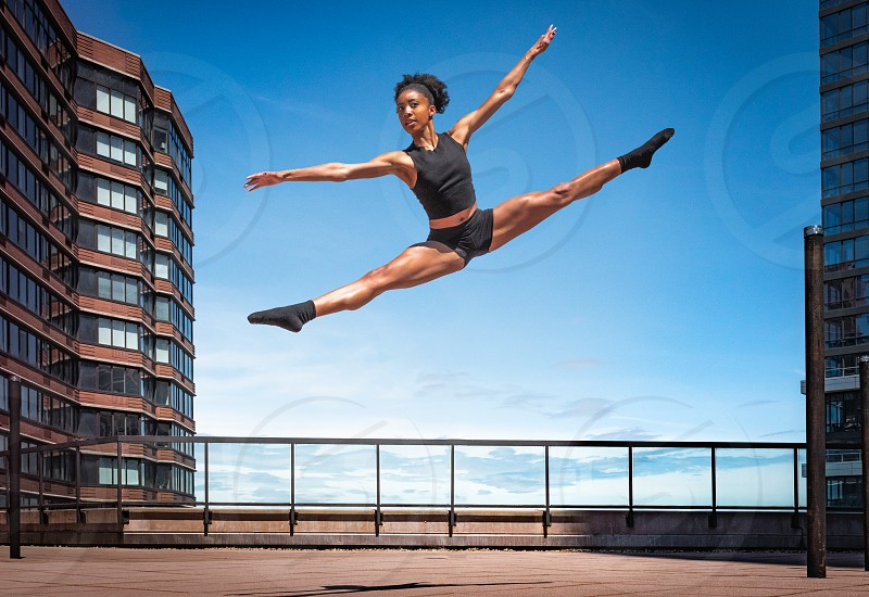 Female dancer jumping in the air photo