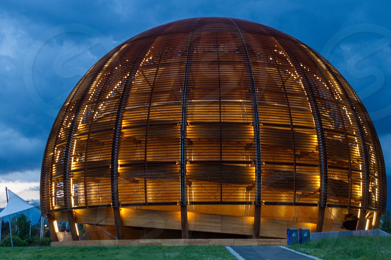 GENEVA SWITZERLAND - JUNE 8 2016: The Globe of Science & Innovation in CERN research center home of Large Hadron Collider LHC buld for test theories of particle physics and measuring the properties of the Higgs boson photo
