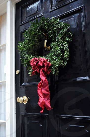green wreath with red bow photo