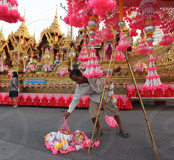 People at the Bun Bang Fai Festival or Rocket Festival in the City of Yasothon in the Region of Isan in Northeast Thailand in Thailand.