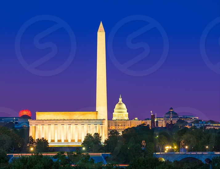 Washington DC skyline with Monument Capitol and Abraham Lincoln memorial sunset photo