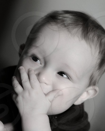 baby wearing black shirt  photo