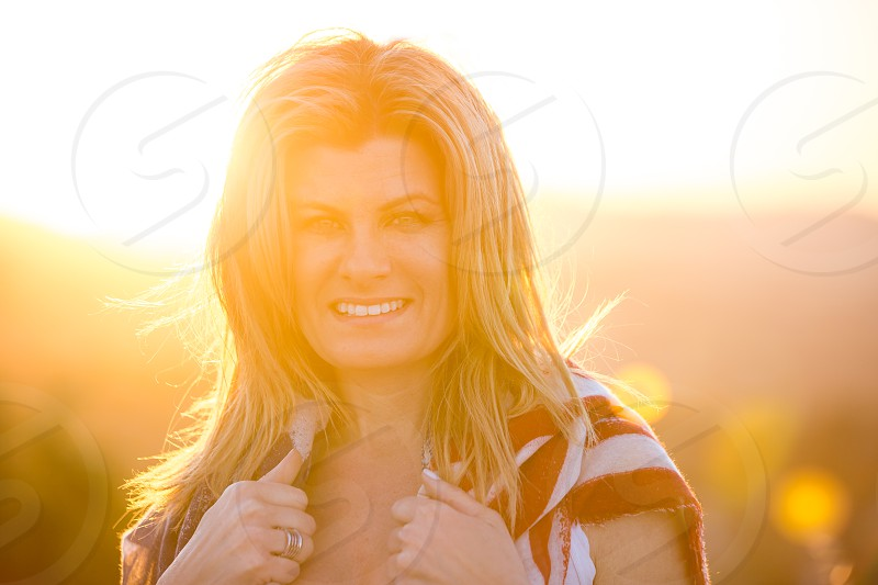 Pretty Blonde woman at Sunset with American Flag photo
