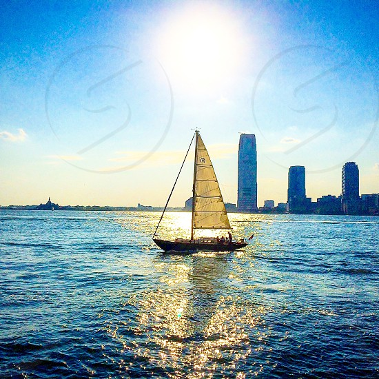 River sail sailing sailboat boat sun sunshine noon Sky Hudson jersey New York Manhattan парус парусник река Гудзон Нью Йорк Манхеттен небо солнце полдень photo
