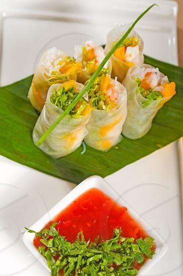 fresh tipycal vietnamese style summer rollson a palm leaf photo