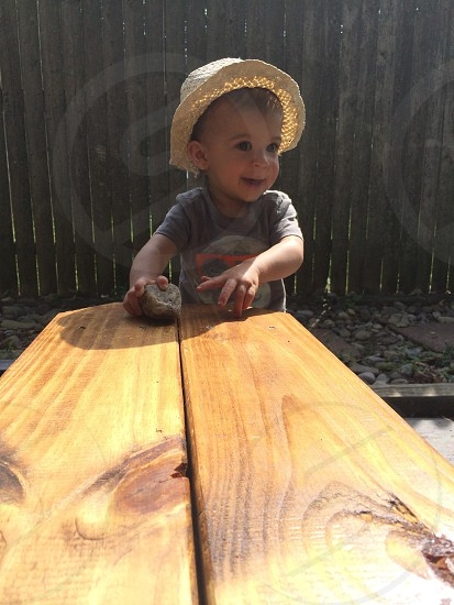 baby at the wooden table photo