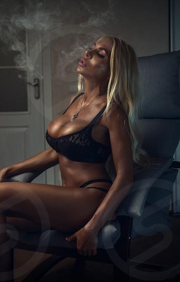 Beautiful girl with the e-cigarette. Big beautiful breasts. photo