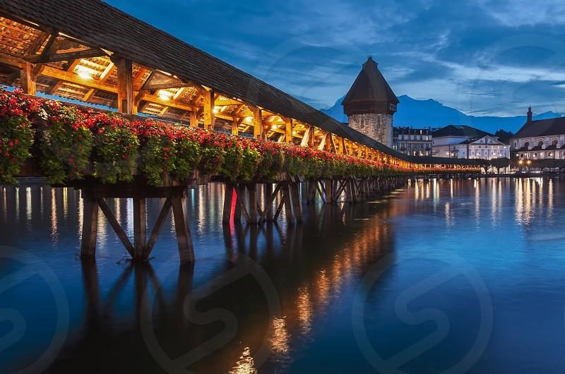Night view of beautiful Chapel Bridge in Lucerne (Kapellbrücke) photo