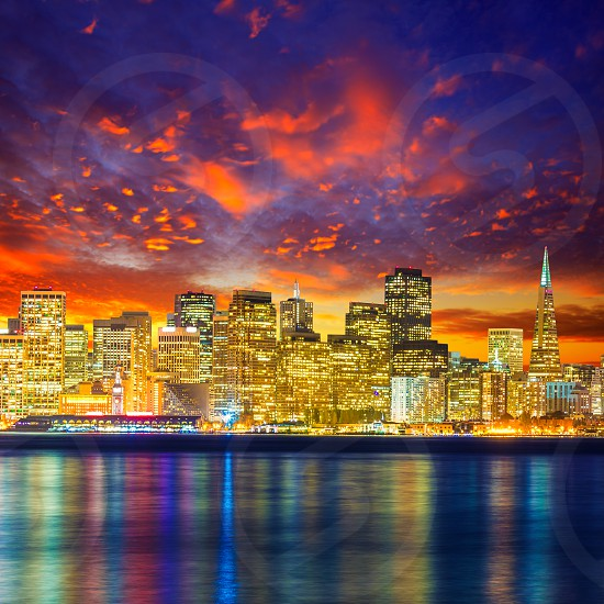 San Francisco sunset skyline in California with reflection in bay water USA photo