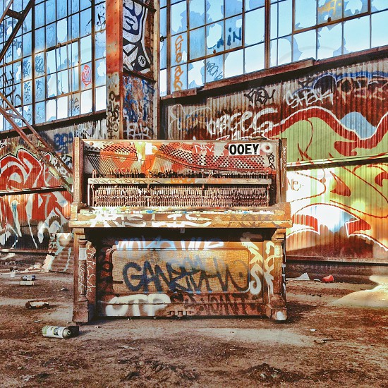 Graffiti covered piano in an old empty warehouse. photo
