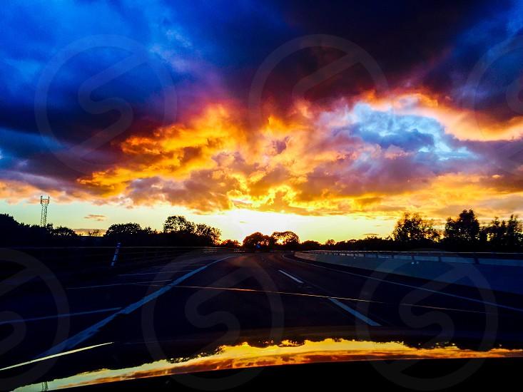 Sunset clouds sky sun photo