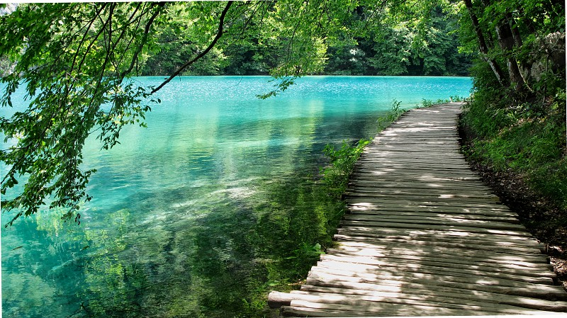 Plitvice National Park Croatia inland turquoise waterfalls limestone clear walkways wooden planks trees magnificent travel destination travel tourist photo