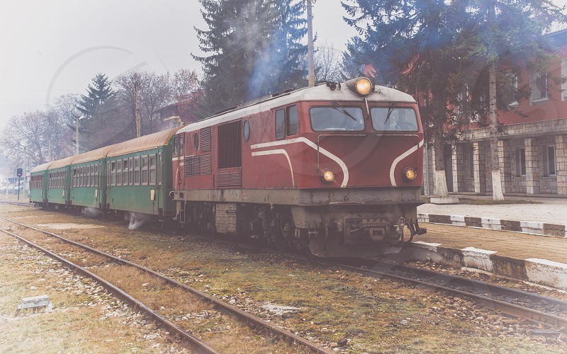 Old vintage train on a railway station. photo