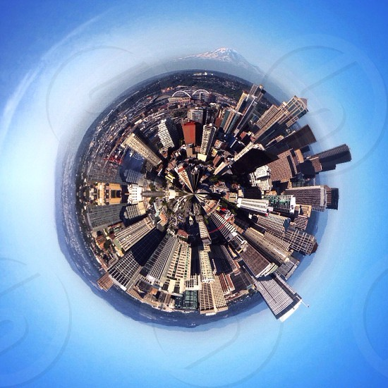 View through a lens on top of a city photo