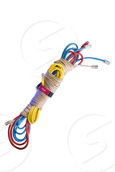 Bundle of computer cords tied in string. photo