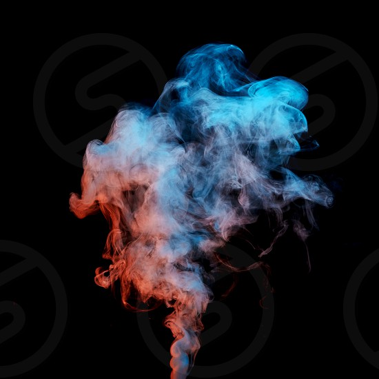 colored smoke stream isolated on a black background photo