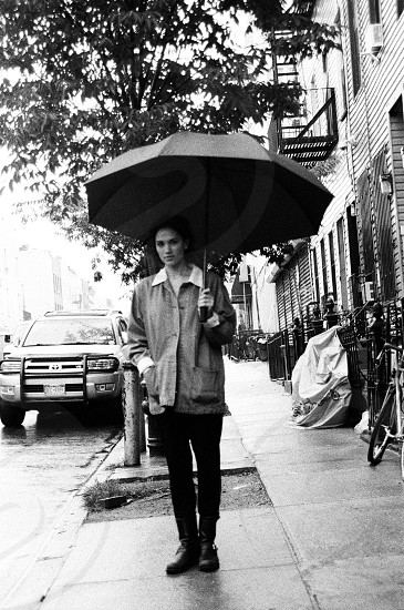 Girl with umbrella in brooklyn. Fashion street brooklyn brooklyn fashion nyc new york ny fashion new york streets woman umbrella raining shoes film camera 35mm film long coat cute road street fashion photo