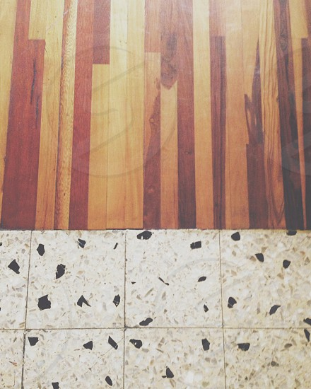 white tiles and brown wooden floor photo photo