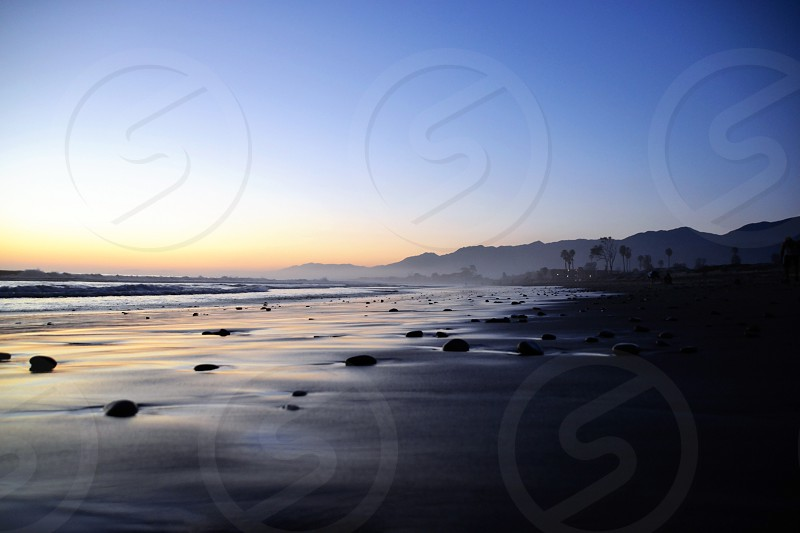 low light photo of seashore during golden hour photo