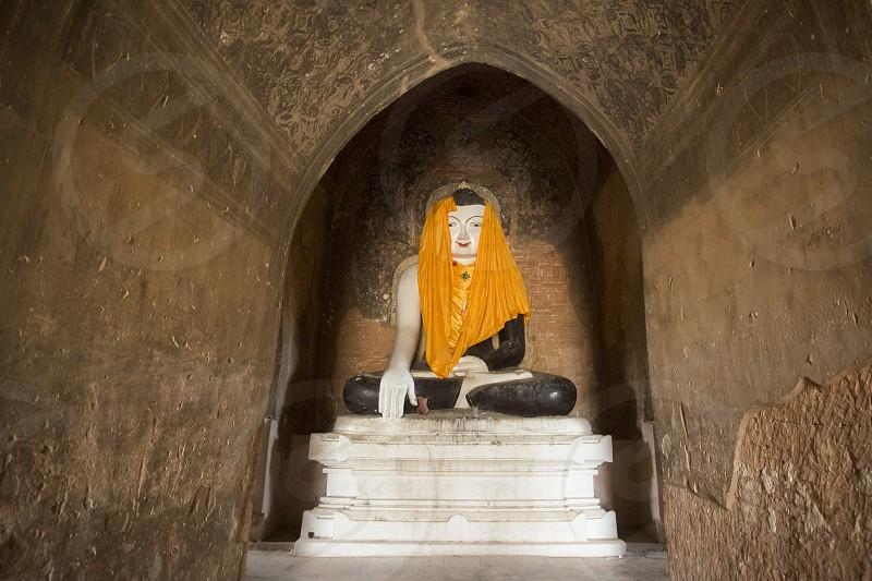 a Buddha figure in a Pagoda in Bagan in Myanmar in Southeastasia. photo