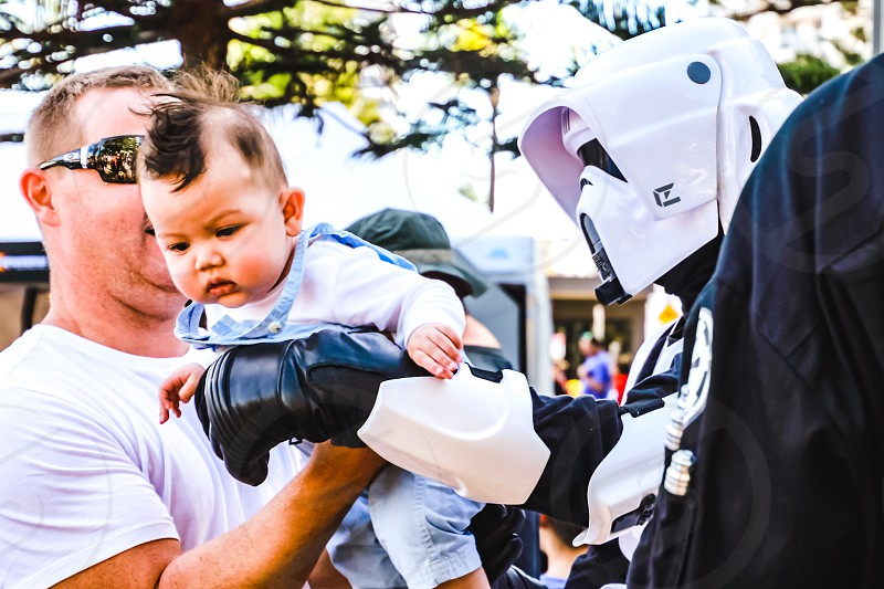 Father baby son and Star Wars character costume festival fictional character fatherhood baby boy with a mohawk  photo
