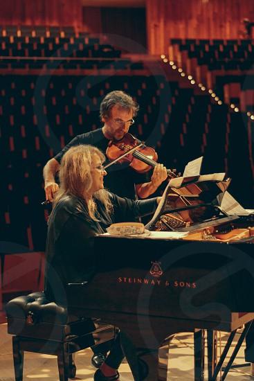 Musicians concert piano violin theatre auditorium  photo