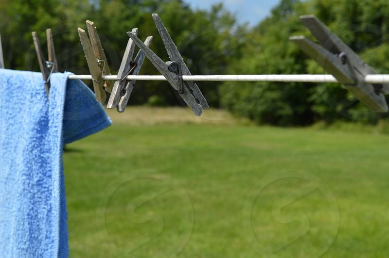 blue towel hanging on clothesline photo