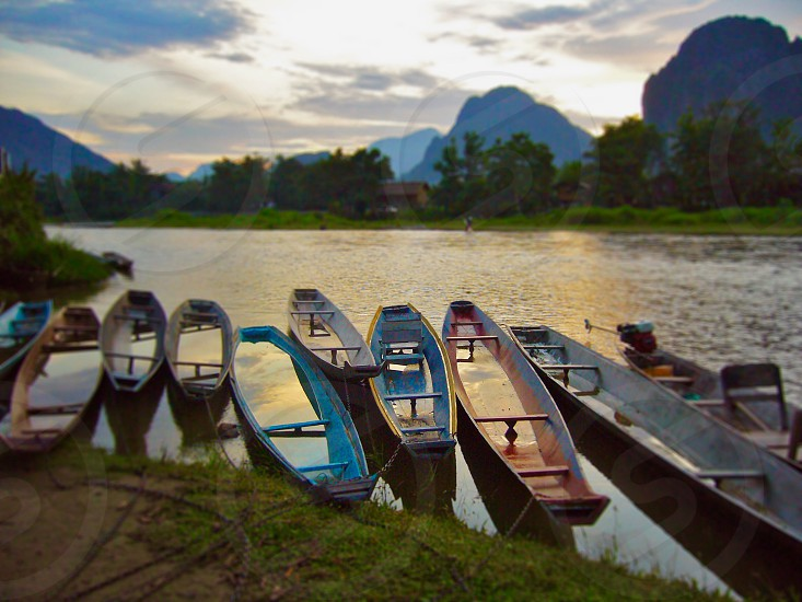 boat river water cruise song namsong vangvieng Vientiane Lao Laos pdr sunset reflection ASEAN southeast Asia photo