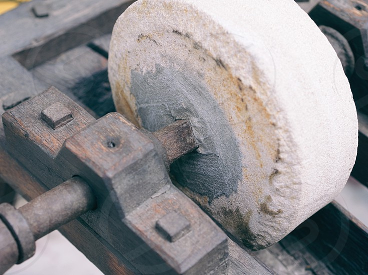 Wooden Manual Old Rotary Grinding Machine Closeup photo