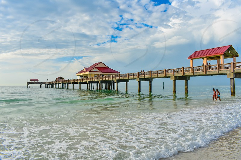 Clearwater Beach Florida. January 25 2019 Panoramic view of Pier 60 on lightblue cloudy background in Gulf Coast Beaches (4) photo