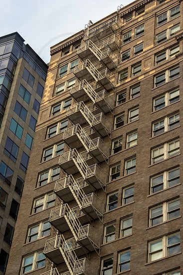 A fire escape down the side of a large downtown building photo